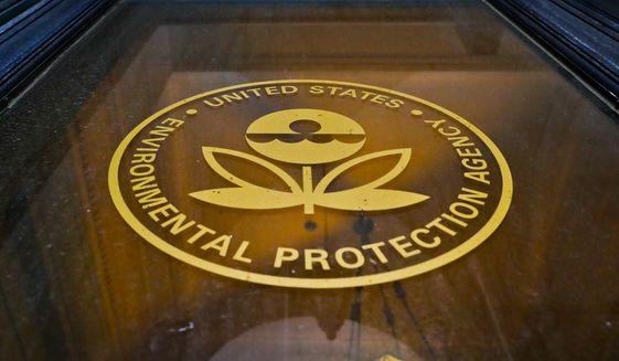 FILE - In this Sept. 21, 2017, file photo, a sign on a door of the Environmental Protection Agency in Washington. Long-running research projects credited with pivotal discoveries about the harm that pesticides, air pollution and other hazards pose to children are in jeopardy or shutting down because the Environmental Protection Agency will not commit to their continued funding, researchers say.  (AP Photo/Pablo Martinez Monsivais, File)