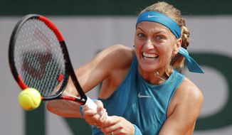 FILE - In this May 28, 2018, file photo, Petra Kvitova, of the Czech Republic, returns a shot against Paraguay's Veronica Cepede Royg during their first round match at the French Open tennis tournament at the Roland Garros stadium in Paris, France. (AP Photo/Christophe Ena, File)