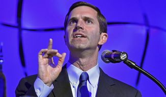 Kentucky Attorney General Andy Beshear addresses his supporters following his victory in the Democratic primary for governor in Louisville, Ky., Tuesday, May 21, 2019.