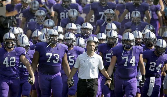 """In this Sept. 27, 2014, file photo, St. Thomas coach Glen Caruso leads his team onto the field for a college football game against St. John's, in St. Paul, Minn. The Minnesota Intercollegiate Athletic Conference has decided to oust the NCAA Division III league's largest school, St. Thomas, for competitive purposes. The MIAC announced Wednesday, May 22, 2019, the Tommies will be """"involuntarily removed"""" in two years by the conference they helped found in 1920. (Jim Gehrz/Star Tribune via AP)"""