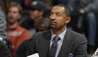 Miami Heat assistant coach Juwan Howard watches during the second half of the team's NBA basketball game against the Denver Nuggets in Denver. Howard has agreed to a five-year deal to take over as Michigan men's basketball coach. (AP Photo/David Zalubowski, File) **FILE**