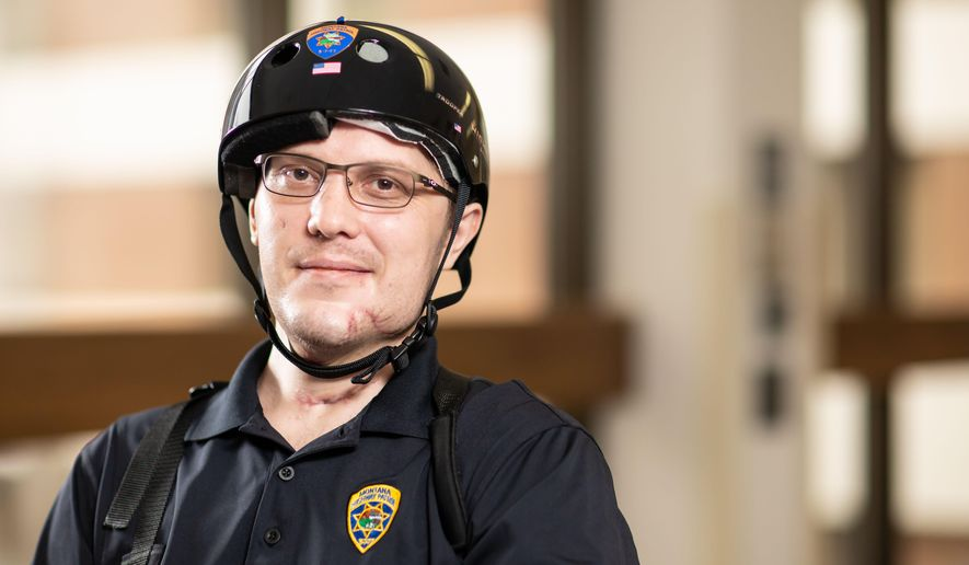 In this image provided by University of Utah Health, Montana Highway Patrol Trooper Wade Palmer poses at University of Utah Health, Wednesday, May 22, 2019, in Salt Lake City. Palmer returned home to Montana on Wednesday to continue his recovery, just over two months after he was shot in the head, face and neck while investigating a fatal shooting. Doctors said Wade Palmer suffered a traumatic brain injury and is unable to speak but seems to understand what is being said. (University of Utah Health via AP)