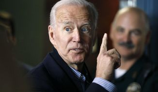 "In this May 13, 2019, photo, former Vice President and Democratic presidential candidate Joe Biden interacts with a supporter during a campaign stop at the Community Oven restaurant in Hampton, N.H.  North Korea has labeled Biden a ""fool of low IQ"" and an ""imbecile bereft of elementary quality as a human being"" after the Democratic presidential hopeful during a recent speech called North Korean leader Kim Jong Un a tyrant. (AP Photo/Michael Dwyer, File)"