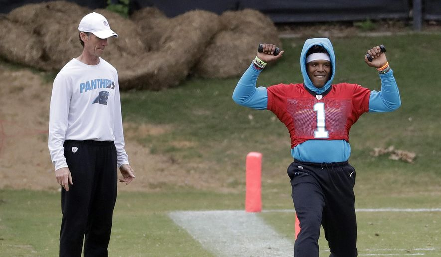 Carolina Panthers' Cam Newton (1) stretches on the sidelines as head trainer Ryan Vermillion watches during the NFL football team's practice in Charlotte, N.C., Wednesday, May 22, 2019. (AP Photo/Chuck Burton) ** FILE **