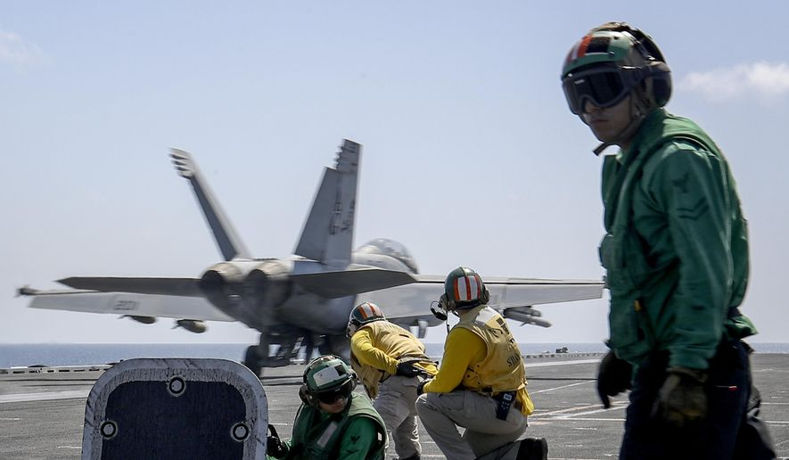 """In this Monday, May 20, 2019, photo, released by U.S. Navy, an F/A-18E Super Hornet from the """"Jolly Rogers"""" of Strike Fighter Squadron (VFA) 103 launches from the flight deck of the Nimitz-class aircraft carrier USS Abraham Lincoln (CVN 72) on the Arabian Sea. (Mass Communication Specialist 3rd Class Jeff Sherman/U.S. Navy via AP)"""