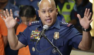 FILE - In this Oct. 24, 2017, file photo, then Philippine National Police Chief Director General Ronald Dela Rosa gestures as he talks to reporters at police headquarters in metropolitan Manila, Philippines. Elections officials were to proclaim the winners Wednesday, May 22, 2019, after finishing the official count of the May 13 elections overnight. President Rodrigo Duterte backed eight winning aspirants to half of the seats in the 24-member Senate, including his former national police chief, Ronald dela Rosa, who enforced the president's crackdown on illegal drugs in a campaign that left thousands of suspects dead and drew international condemnation. (AP Photo/Aaron Favila, File)