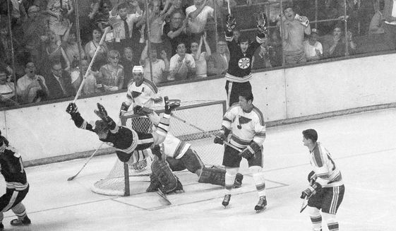 In this May 10, 1970, file photo, Boston Bruins' Bobby Orr flies through the air after driving the winning goal past St. Louis Blues' goalie Glenn Hall in the sudden death period of their NHL finals of the Stanley Cup Series, in Boston Garden. Orr and the big, bad Boston Bruins swept the expansion-era Blues in that series. Now 49 years later, Boston is in its third final in nine seasons and St. Louis is back for the first time since 1970. (AP Photo/A.E. Maloof) **FILE**