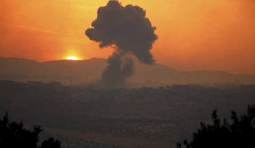 This photo provided Tuesday, May 21, 2019 by the Syrian Civil Defense group known as the White Helmets, shows smoke rising after Syrian government forces targeted the town of al-Habeet, in Idlib province, Syria. Syrian activists and a rebel spokesman said Wednesday, May 22, 2019 that opposition fighters have recaptured Kfar Nabuda, a village at the edge of the last rebel stronghold in northwestern Syria. (Syrian Civil Defense White Helmets via AP)