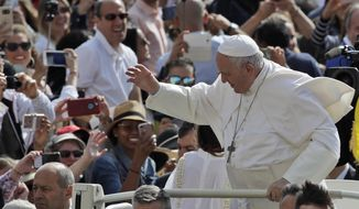 Pope Francis arrives for his weekly general audience in St. Peter's square at the Vatican, Wednesday, May 22, 2019. (AP Photo/Alessandra Tarantino)