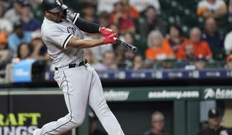 Chicago White Sox's Eloy Jimenez hits a home run against the Houston Astros during the eighth inning of a baseball game Wednesday, May 22, 2019, in Houston. (AP Photo/David J. Phillip)