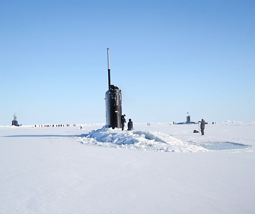 The Seawolf-class fast-attack submarine USS Connecticut (SSN 22), left, Los Angeles-class fast-attack submarine USS Hartford (SSN 768), center, and the Royal Navy hunter killer submarine, HMS Trenchant (S-91) surface through the ice during the multinational maritime Ice Exercise (ICEX) in the Arctic Circle. ICEX 2018 is a five-week exercise that allows the Navy to assess its operational readiness in the Arctic, increase experience in the region, advance understanding of the Arctic environment, and continue to develop relationships with other services, allies and partner organizations. (U.S. Navy photo by Chief Mass Communication Specialist  Darryl I. Wood/Released) ** FILE **