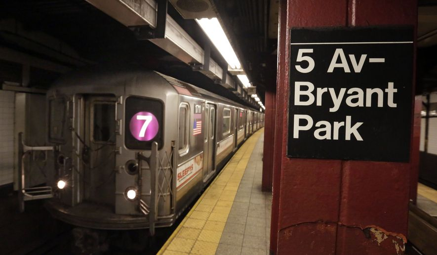 In this Dec. 4, 2013 photo, a #7 New York City subway train arrives in the 5th Avenue-Bryant Park station, in New York. Noise from screeching subway trains can be overwhelming, sometimes rising up out of the caverns trains operate in and into the buildings above.  (AP Photo/Richard Drew)