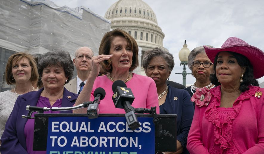 Speaker of the House Nancy Pelosi, D-Calif., center, flanked by Rep. Lois Frankel, D-Fla., left, and Rep. Frederica Wilson, D-Fla., right, joins members of the Democratic Women's Caucus and the Pro-Choice Caucus at a news conference on Roe vs. Wade and women's rights, at the Capitol in Washington, Thursday, May 23, 2019. (AP Photo/J. Scott Applewhite)