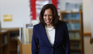 Democratic presidential Candidate Sen. Kamala Harris, D-Calif., greets students at Miller Elementary School in Dearborn, Mich., Monday, May 6, 2019. (AP Photo/Paul Sancya) ** FILE **