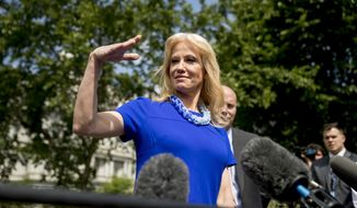 Counselor to the President Kellyanne Conway, accompanied by Marc Short, Chief of Staff for Vice President Mike Pence, right, gestures as she mimics House Speaker Nancy Pelosi of Calif. who she accused of being dismissive to Conway during yesterday's meeting on infrastructure as Conway speaks to reporters outside the West Wing of the White House in Washington, Thursday, May 23, 2019.(AP Photo/Andrew Harnik)