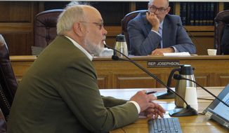 Joe Geldhof, left, testifies before the Alaska House Finance Committee on Thursday, May 23, 2019, in Juneau, Alaska, as Rep. Andy Josephson listens. The committee heard a bill that proposes a full Alaska Permanent Fund dividend this year but seeks changes to the dividend formula going forward. (AP Photo/Becky Bohrer)