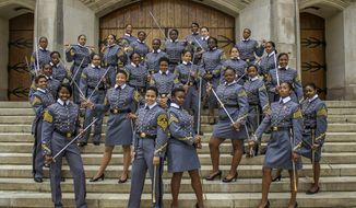 In this May 7, 2019 photo, black female cadets with the Class of 2019 pose at the U.S. Military Academy in West Point, N.Y. The 34 women comprise a small slice of the roughly 1,000 cadets in the class. The cadets say they're proud to be part of a milestone at the historic academy after four years of testing their limits. (Cadet Hallie H. Pound/U.S. Army via AP)