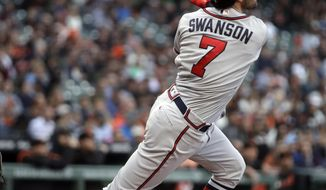 Atlanta Braves' Dansby Swanson watches his three-run home run off San Francisco Giants' Jeff Samardzija during the second inning of a baseball game Wednesday, May 22, 2019, in San Francisco. (AP Photo/Ben Margot)
