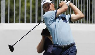 Jordan Spieth hits from the ninth tee during the first round of the Charles Schwab Challenge golf tournament at Colonial Country Club in Fort Worth, Texas, Thursday, May 23, 2019. (Bob Booth/Star-Telegram via AP)