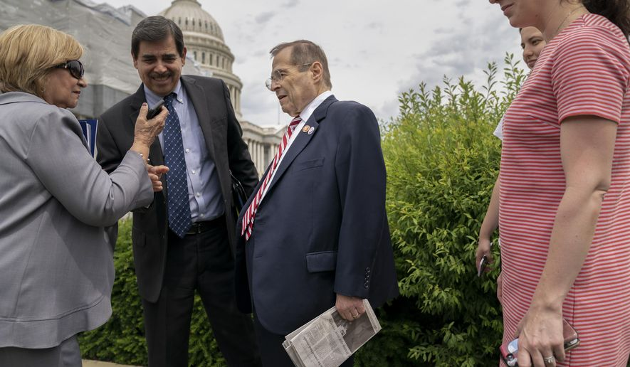 Two people ask to take a photo with House Judiciary Committee Chairman Jerrold Nadler, D-N.Y., center, as the Senate and the House of Representatives shut down for the week-long Memorial Day recess, at the Capitol in Washington, Thursday, May 23, 2019. Rep. Nadler, whose district covers parts of Manhattan and Brooklyn in New York, has gained notoriety by leading one of the House committees investigating President Donald Trump. (AP Photo/J. Scott Applewhite)