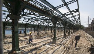 Workers rebuild and refurbish the central station in Havana, Cuba, Wednesday, May 22, 2019. Cuba's railway system is undergoing a major overhaul, with the government pushing a program to revamp the decrepit and aging network with new cars and locomotives in the hope of restoring a rail service that was once the envy of Latin America. (AP Photo/Ismael Francisco)