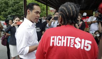 Presidential candidate and former U.S. Department of Housing and Urban Development Julian Castro speaks with a supporter prior to rallying with McDonald's employees and other activists demanding fairer pay, better working conditions, and the right to unionize in Durham, N.C., Thursday, May 23, 2019. (AP Photo/Gerry Broome)