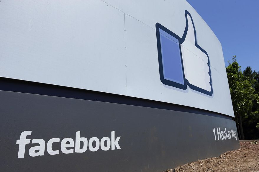 FILE - This July 16, 2013 file photo shows a sign at Facebook headquarters in Menlo Park, Calif. Facebook said in a Thursday, May 23, 2019 report, it removed more than 3 billion fake accounts from the service in the October-March period, although it doesn't say how many it also missed. The report comes as Facebook grapples with challenges ranging from fake news to its role in elections interference, hate speech and incitement to violence in the U.S., Myanmar, India and elsewhere. (AP Photo/Ben Margot, File)