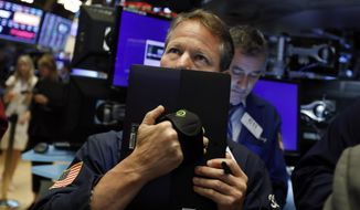 FILE - In this May 17, 2019, file photo trader Robert Charmak works on the floor of the New York Stock Exchange. The U.S. stock market opens at 9:30 a.m. EDT on Thursday, May 23. (AP Photo/Richard Drew, File)