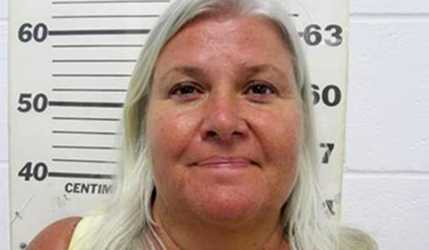 FILE - In this undated file photo provided by the South Padre Island, Texas, Police Department shows Lois Riess, of Blooming Prairie, Minn. A grand jury in Minnesota indicted the 57-year-old woman who authorities allege fatally shot her husband before fleeing to Florida and killing a woman there. Riess led authorities on a cross-country manhunt before she was captured in Texas on April 19, 2018, at a South Padre Island waterfront restaurant by two federal deputy marshals. (South Padre Island Police Department via AP, File)