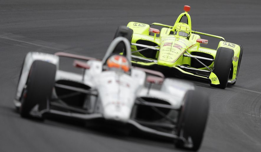 Simon Pagenaud, of France, follows Santino Ferrucci into turn one during practice for the Indianapolis 500 IndyCar auto race at Indianapolis Motor Speedway, Monday, May 20, 2019, in Indianapolis. (AP Photo/Darron Cummings) ** FILE **
