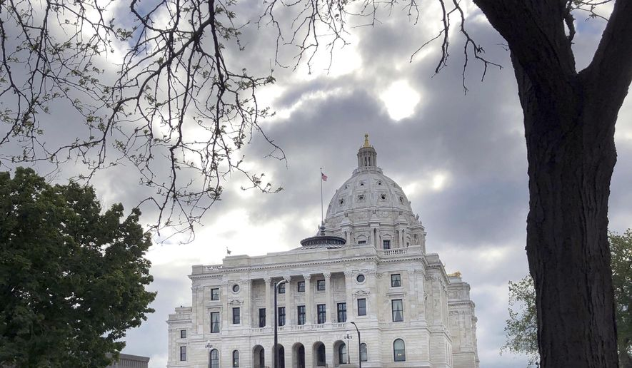 The sun breaks through the clouds over the Minnesota Capitol in St. Paul, Minn., Thursday, May 23, 2019. Gov. Tim Walz and top legislative leaders reached agreement Thursday on the last of their major budget bills, leaving lawmakers waiting on the governor to call a special session to finish their work for the year.  (AP Photo/Steve Karnowski)