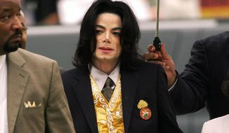 In this May 25, 2005 file photo, Michael Jackson arrives at the Santa Barbara County Courthouse for his trial in Santa Maria, Calif. (Aaron Lambert/Santa Maria Times via AP, Pool)