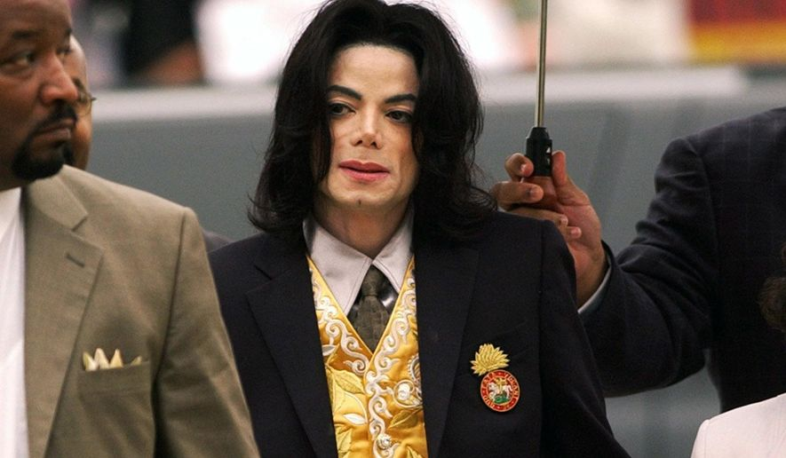 In this May 25, 2005 file photo, Michael Jackson arrives at the Santa Barbara County Courthouse for his trial in Santa Maria, Calif. (Aaron Lambert/Santa Maria Times via AP, Pool)