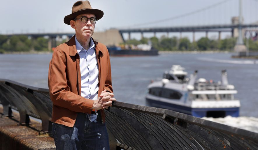 Kevin Kusinitz, a 63-year-old New Yorker who spent years being rejected from jobs for which he felt overqualified following an August 2012 layoff, poses for a photo on New York's East River, Wednesday, May 22, 2019. About half of Americans think there's age discrimination in the workplace, according to a new poll by The Associated Press-NORC Center for Public Affairs Research. (AP Photo/Richard Drew)