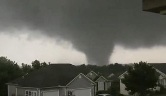This still image taken from video provided by Chris Higgins shows a tornado, Wednesday, May 22, 2019, in Carl Junction, Mo. The tornado caused some damage in the town of Carl Junction, about 4 miles (6.44 kilometers) north of the Joplin airport. (Chris Higgins via AP)