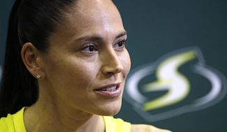 Seattle Storm's Sue Bird talks with media members at the basketball team's media day Monday, May 13, 2019, in Seattle. The Storm is the defending WNBA champion. (AP Photo/Elaine Thompson) **FILE**
