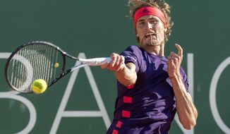 Alexander Zverev, of Germany, returns a ball to Hugo Dellien of Bolivia, during their quarter final match, at the ATP 250 Geneva Open tournament in Geneva, Switzerland, Thursday, May 23, 2019. (Martial Trezzini, Keystone via AP)