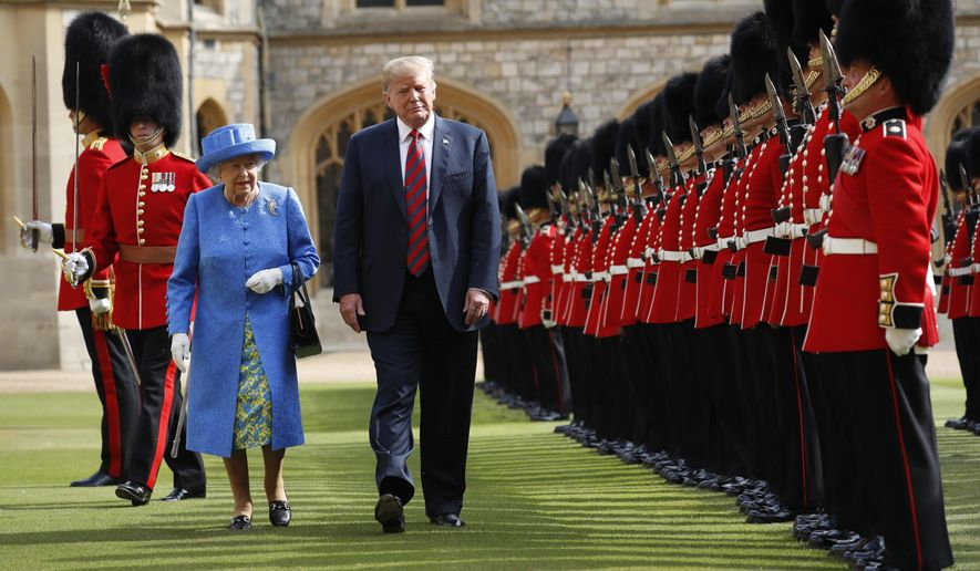President Donald Trump with Queen Elizabeth II inspects the Guard of Honour at Windsor Castle in Windsor, England on  July 13, 2018. (AP file photo/Pablo Martinez Monsivais) ** FILE **