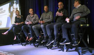 From left, University of Connecticut NCAA women's soccer coach Margaret Rodriguez, men's hockey coach Mike Cavanaugh, football coach Randy Edsall, men's basketball coach Dan Hurley and women's basketball coach Geno Auriemma speak on Thursday, May 23, 2019, at Dunkin' Donuts Park in Hartford, Conn. The coaches are touring the state as part of the second annual Coaches Road Show to engage the school's fan base. (AP Photo/Pat Eaton-Robb)