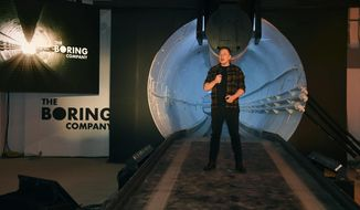 FILE - In this Dec. 18, 2018 file photo Elon Musk, co-founder and chief executive officer of Tesla Inc., speaks during an unveiling event for the Boring Co. Hawthorne test tunnel in Hawthorne, Calif. The Boring Company, backed by tech billionaire Musk has been granted a nearly $49 million contract to build a transit system using self-driving vehicles underneath the Las Vegas Convention Center. (Robyn Beck/Pool Photo via AP, File)
