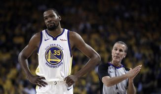 In this Wednesday, May 8, 2019, file photo, Golden State Warriors' Kevin Durant, left, walks away from referee Ken Mauer during the first half of Game 5 of the team's second-round NBA basketball playoff series against the Houston Rockets in Oakland, Calif. Durant is yet to progress to on-court work in his recovery from a strained right calf and won't be ready to return for Golden State in Game 1 of the NBA Finals on May 30. (AP Photo/Ben Margot, File) **FILE**