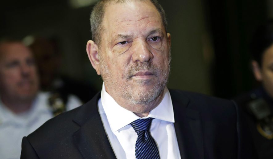 FILE - In this Oct. 11, 2018, file photo, Harvey Weinstein enters State Supreme Court in New York. A tentative deal is close to settling lawsuits brought against the television and film company co-founded by Weinstein, who has been accused of sexual misconduct by scores of women. (AP Photo/Mark Lennihan, File)