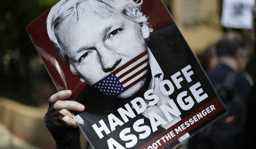 In this May 1, 2019, file photo, protesters demonstrate outside court where Julian Assange will appear in London. (AP Photo/Matt Dunham, File)