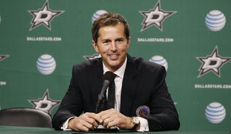 FILE - In this Nov. 22, 2014, file photo, NHL Hall of Fame class of 2014 inductee Mike Modano talks about his time in the league during a press conference before an NHL hockey game between the Dallas Stars and Los Angeles Kings in Dallas. Modano has decided to return to his NHL roots in Minnesota. The Hall of Fame center was named executive adviser to Minnesota Wild owner Craig Leipold and president Matt Majka on Thursday, May 23, 2019. (AP Photo/Brandon Wade, File)