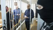 Paul Whelan, a former U.S. Marine, center, waits for a hearing in a court in Moscow, Russia, Friday, May 24, 2019.  (AP Photo/Pavel Golovkin)