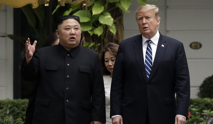 In this Feb. 28, 2019, file photo, U.S. President Donald Trump and North Korean leader Kim Jong-un take a walk after their first meeting at the Sofitel Legend Metropole Hanoi hotel in Hanoi, Vietnam. North Korea says nuclear negotiations with the United States will never resume unless Washington changes its negotiating tactics.  (AP Photo/Evan Vucci, File)