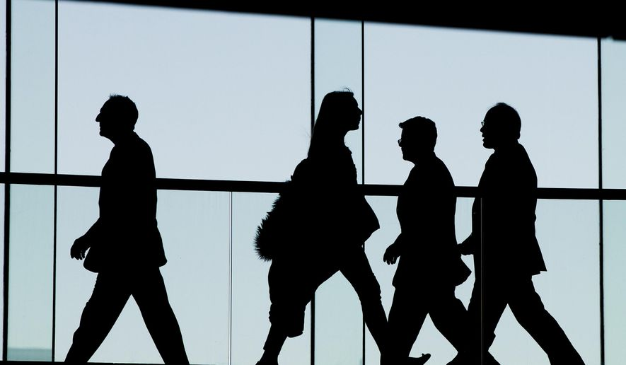 FILE - In this Tuesday, Jan. 5, 2016, file photo, people walk at the National Constitution Center in Philadelphia. Americans generally do not have enough saved for retirement and Congress is considering a number of measures to address that. (AP Photo/Matt Rourk, File)