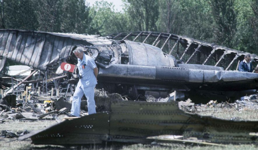 FILE - In this May 26, 1979 file photo, investigators view the wreckage of the ill-fated American Airlines Flight 191 to Los Angeles, which crashed on take off from O'Hare International Airport in Chicago. Decades later, the crash, moments after it took off, remains the deadliest aviation accident in U.S. history. The DC-10 was destined for Los Angeles when it lost one of its engines May 25, 1979, killing what investigators later determined were 273 people _ all 271 people aboard the jetliner and two people on the ground. (AP Photo/Fred Jewell File)