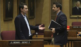 Two Republican holdouts on a proposed Arizona state budget, Senators Paul Boyer, left, and J.D. Mesnard confer on the Senate floor during a break in the action in Phoenix, Ariz., Friday, May 24, 2019. Republicans who control the state legislature are trying to wrangle enough support from holdouts like Boyer and Mesnard to pass the deal the $11.8 billion state budget package they negotiated with GOP Gov. Doug Ducey. Arizona House lawmakers worked into the early morning Friday to pass several bills that are part of the state budget before calling it a night while the Senate took the night off because it lacked the votes to enact budget legislation. (AP Photo/Bob Christie)
