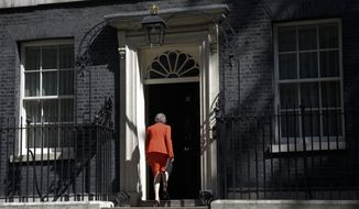 British Prime Minister Theresa May walks away after making a speech in the street outside 10 Downing Street in London, England, Friday, May 24, 2019. Theresa May says she'll quit as UK Conservative leader on June 7, sparking contest for Britain's next prime minister. (AP Photo/Alastair Grant)